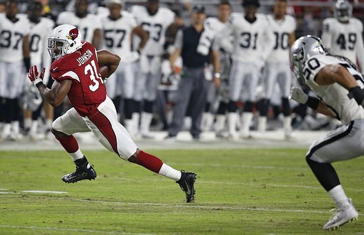 Arizona Cardinals running back David Johnson (31) runs in the open field as he gets past Oakland Raiders' Ben Heeney (50) during the first half of an NFL preseason football game Friday, Aug. 12, 2016, in Glendale, Ariz.