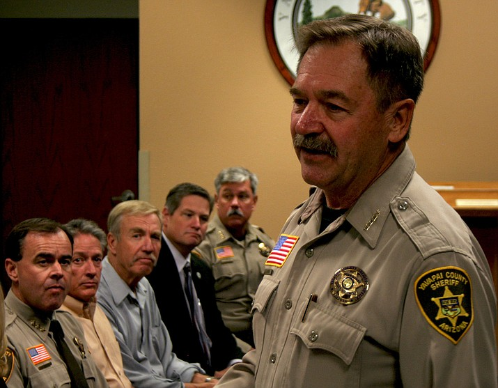 Sheriff Scott Mascher speaks to the crowd assembled for the promotion ceremony Thursday, Aug. 11, as incoming Chief Deputy Dave Rhodes, County Supervisors Chip Davis, Tom Thurman, Jack Smith and retiring Chief Deputy John Russell listen.