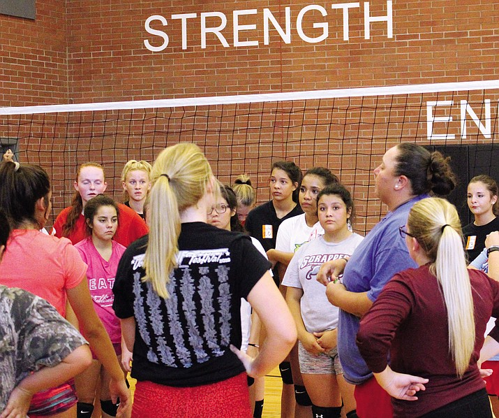 Lee Williams' first year volleyball coach Julia Lasiloo addresses the team at the end of tryouts Wednesday.