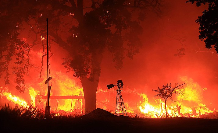 A two-story structure burns in a subdivision off Morgan Valley Road as a wildfire burns in Lower Lake, Calif., Saturday Aug. 13. More evacuation orders have been issued as the wildfire grows in Northern California, threatening the lake community of about 1,300 that was evacuated a year ago because of a destructive fire.