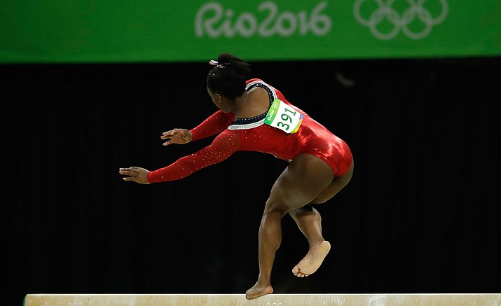 United States' Simone Biles nearly falls during her performance on the balance beam during the artistic gymnastics women's apparatus final at the 2016 Summer Olympics in Rio de Janeiro, Brazil, Monday, Aug. 15.
