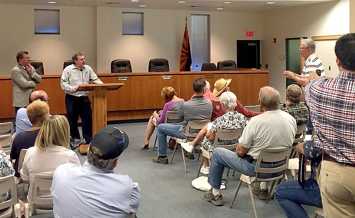 Steve Mauk, Yavapai County Development Services director, far left, and Deputy County Attorney Jack Fields listen as state Rep. Noel Campbell, right, speaks about recovery homes Aug. 15 at the county Administration building. A second meeting takes place Aug. 25.