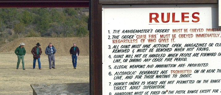 Forest Service and National Rifle Association officials walk the Prescott Sportmen's Club Shooting Range in December 2001.