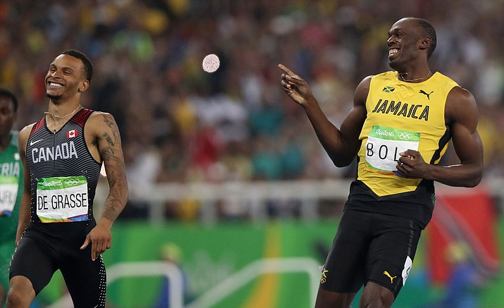 Jamaica's Usain Bolt, right, and Canada's Andre De Grasse compete in a men's 200-meter semifinal during the athletics competitions of the 2016 Summer Olympics at the Olympic stadium in Rio de Janeiro, Brazil, Wednesday, Aug. 17.