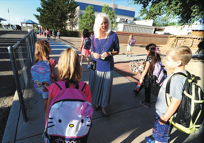Del Rio Elementary School Principal Carolyn Reeder (center) greets students arriving for the first day of classes on Tuesday, Aug. 9.