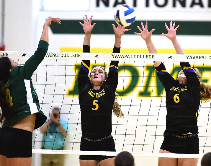 Embry Riddle's Jordan Jones (5) and Madison Fancher (6) go for a block during a volleyball scrimmage against Yavapai College August 16, 2016 in Prescott. (Les Stukenberg/The Daily Courier)