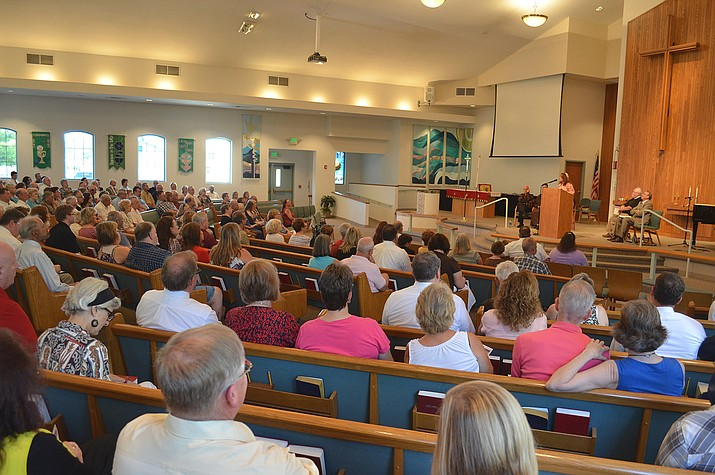 Religious leaders from the Kingman Unified Pastoral Association brought in a packed house at Grace Lutheran Church Sunday night.