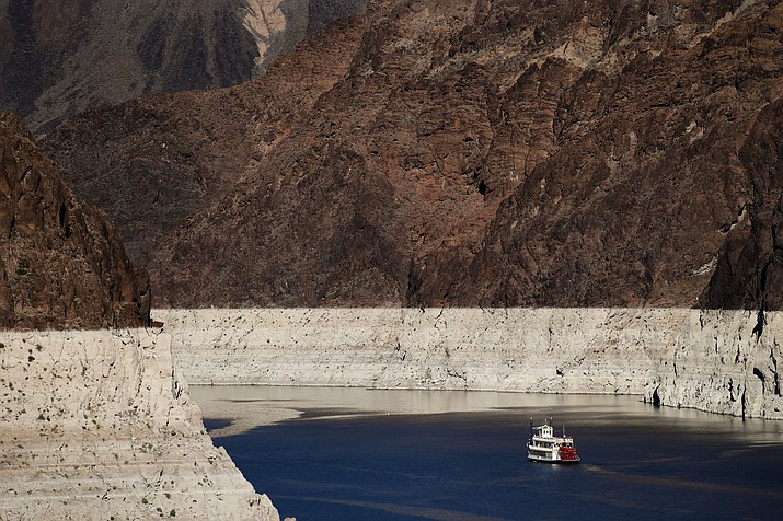 A riverboat glides through Lake Mead on the Colorado River at Hoover Dam near Boulder City, Nevada, on Oct. 14, 2015.