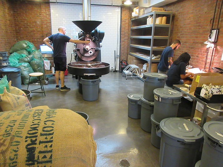 Warwick Mayn, left, head roaster at Parlor Coffee, roasts beans at the company's facility in Brooklyn. As part of the latest wave of U.S. coffee culture, consumers interested in specialty coffees are showing a willingness to spend more on beans and grinders and are eager to learn more about how coffee is grown and prepared.