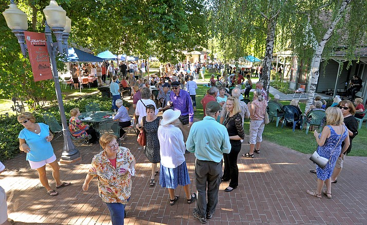 "People fill the grounds at Sharlot Hall Museum during 2015's Sharlot's Cellar ""99 Bottles of Wine at the Hall"" wine tasting in downtown Prescott. This year's event is Saturday, Aug. 20."
