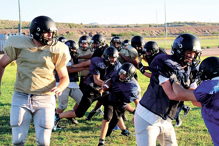 Kingman Academy's defensive line is expected to step this year for the Tigers.