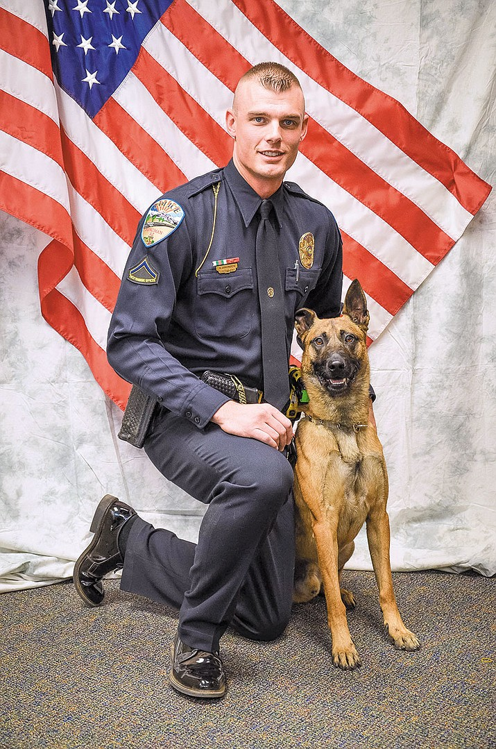 Officer Adam Simonsen and his K-9 partner Amigo. Amigo died Saturday while receiving treatment for a heat-related sickness.