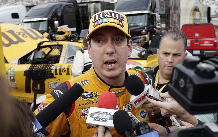 Kyle Busch speaks to media after crashing during a NASCAR Sprint Cup Series auto race, Sunday, Aug. 21, 2016 in Bristol, Tenn. The race was delayed Saturday night due to severe weather.