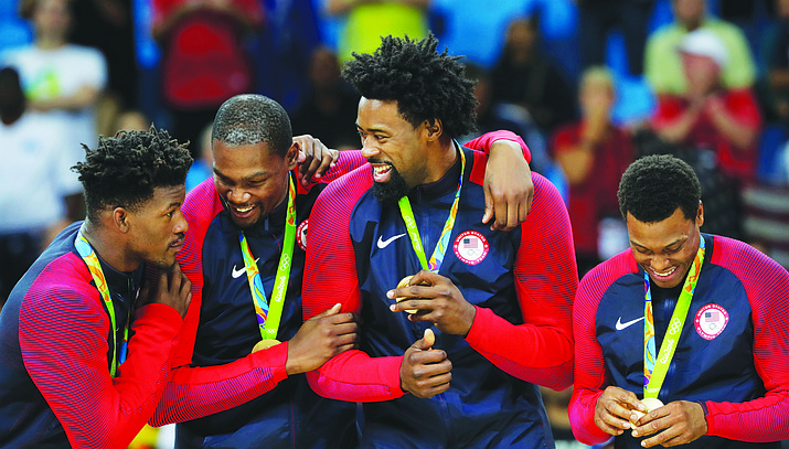 United States' Jimmy Butler, from left, Kevin Durant, DeAndre Jordan and Kyle Lowry stand on the podium with their gold medals for men's basketball at the 2016 Summer Olympics in Rio de Janeiro, Brazil, Sunday, Aug. 21.