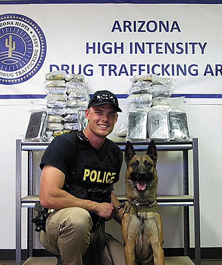 Kingman Police officers Adam Simonsen and his late partner, Amigo, whose end of watch was Saturday.
