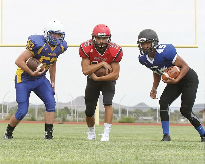 Kingman's Jeremy Stewart (52), Lee Williams' Andrew Davis (16) and Kingman Academy's Jordan McDowell-Seybert (45) get the high school fall sports season underway. See the links below for a complete football preview.