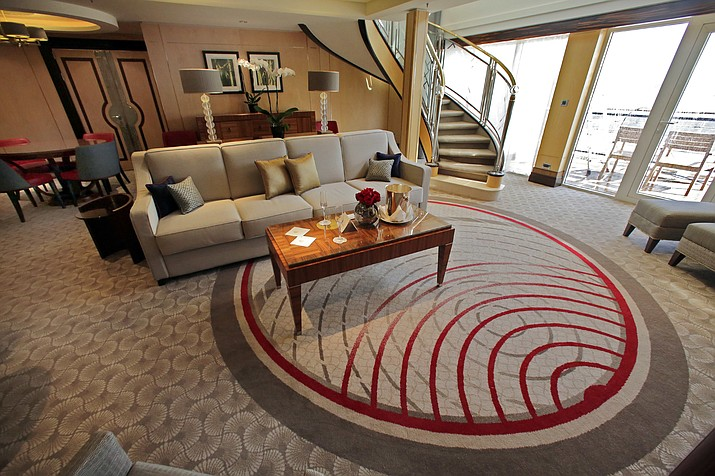 In this July 6, 2016 photo, the Queens Grill Balmoral Suite living room is shown aboard the cruise liner Queen Mary 2, docked at the Brooklyn Cruise Terminal, in New York. (AP Photo/Richard Drew)