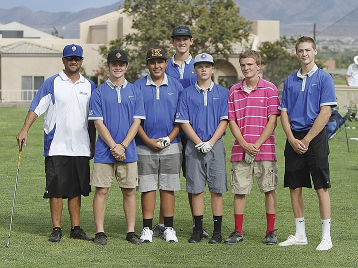 Kingman High School boys golf team. From left to right, Coach Chad Baitinger, Derek Brown, Matthew Mendez, Landin Jones, Hayden Tanner, Britton Ogle and Sid Jenson.