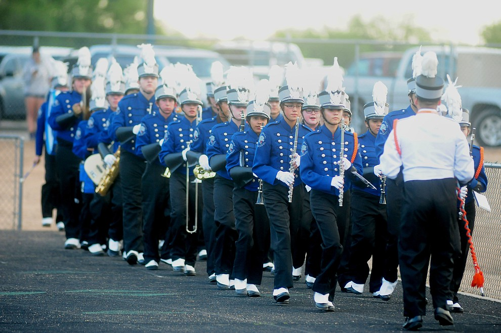 The Chino Valley Band marches onto the field as the Chino Valley Cougars host the Camp Verde Cowboys to open the 2016 AIA football season Friday, August 26, 2016. (Les Stukenberg/PNI Photo)