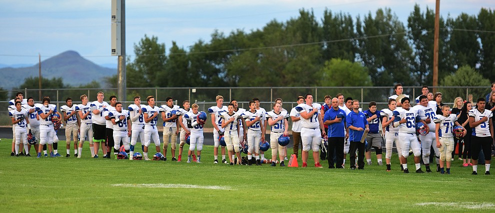 Camp Verde stands for the National Anthem as the Chino Valley Cougars hosted the Camp Verde Cowboys to open the 2016 AIA football season Friday, August 26, 2016. (Les Stukenberg/PNI Photo)
