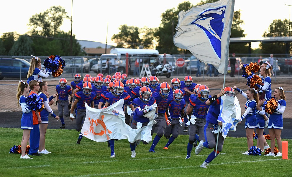 Chino Valley runs onto the field as the Chino Valley Cougars hosted the Camp Verde Cowboys to open the 2016 AIA football season Friday, August 26, 2016. (Les Stukenberg/PNI Photo)