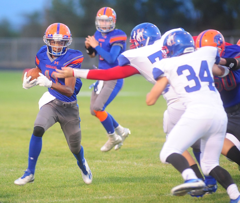 Chino Valley's Gavin Thompson (11) tries to break around the end as the Chino Valley Cougars hosted the Camp Verde Cowboys to open the 2016 AIA football season Friday, August 26, 2016. (Les Stukenberg/PNI Photo)