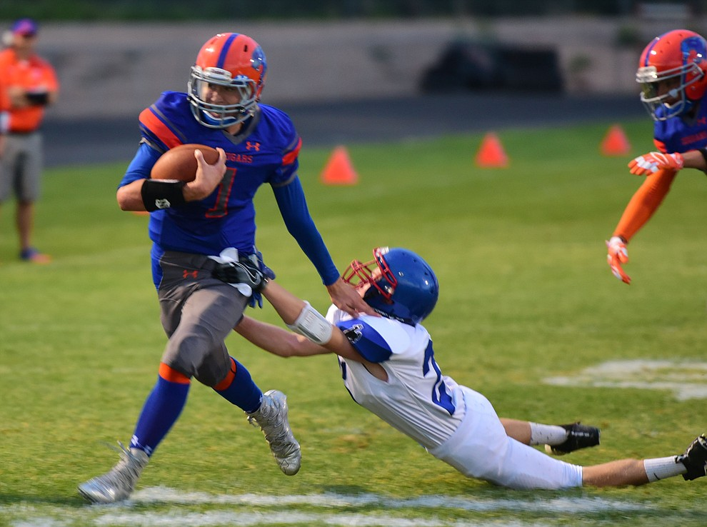 Chino Valley's Josh Fisher (1) stiff arms a defender enroute too the opening touchdown as the Chino Valley Cougars hosted the Camp Verde Cowboys to open the 2016 AIA football season Friday, August 26, 2016. (Les Stukenberg/PNI Photo)