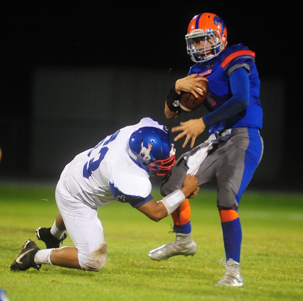 Camp Verde's Dillon Tressler (53) gets to Chino Valley quarterback Josh Fisher (1) as the Chino Valley Cougars hosted the Camp Verde Cowboys to open the 2016 AIA football season Friday, August 26, 2016. (Les Stukenberg/PNI Photo)