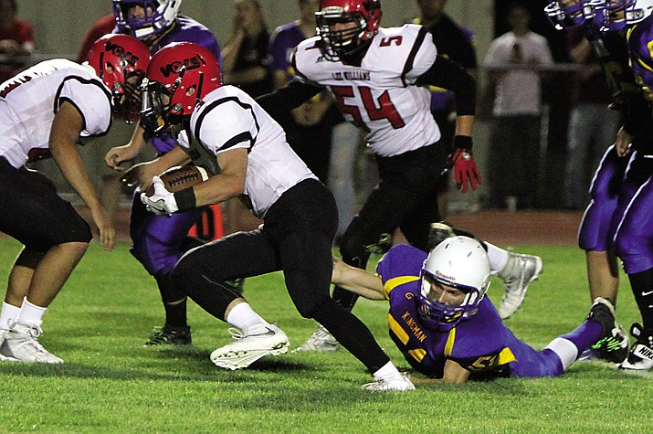 Lee Williams rushed for 250 yards at part of its 352 yards of total offense in the Volunteers' 28-6 win Friday at Kingman. Paul Giglio (3) rushed for 158 yards for two touchdowns and two 2-point conversions.