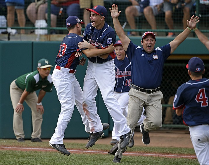 Endwell, N.Y.'s Ryan Harlost, center, begins to celebrate with teammate Jack Hopko, left, after getting the final out of the Little League World Series Championship baseball game against South Korea in South Williamsport, Pa., Sunday, Aug. 28. New York won 2-1.