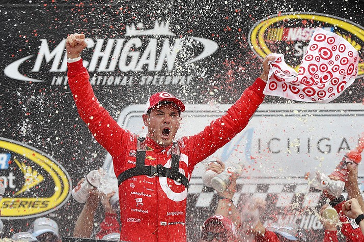 Kyle Larson celebrates after winning the NASCAR Sprint Cup Series auto race at Michigan International Speedway in Brooklyn, Mich., Sunday, Aug. 28.