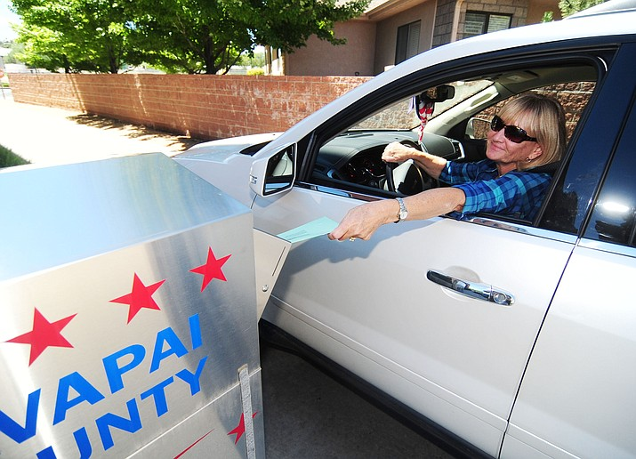 Nancy Stamile drops off her primary election ballot at the Yavapai County Administration Building Monday, August 29, 2016. (Les Stukenberg/The Daily Courier)