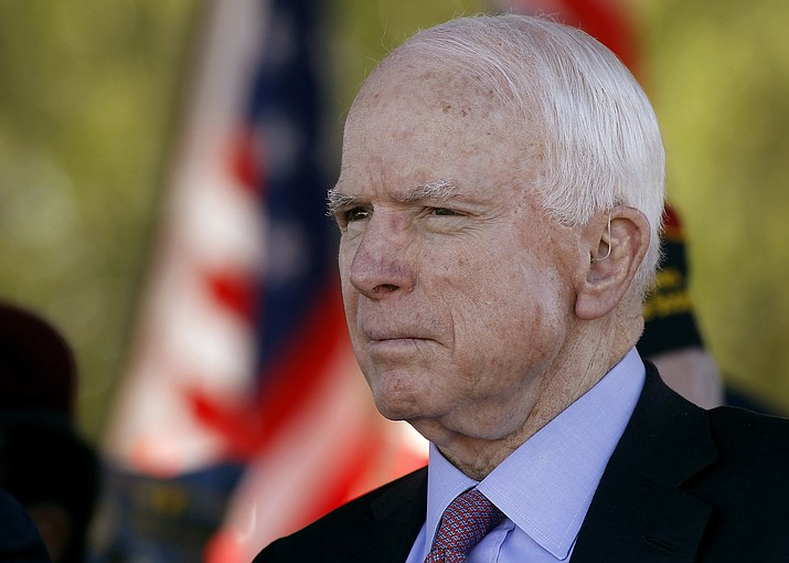 In this Monday, May 30, 2016, file photo, Sen. John McCain, R-Ariz, looks on during a Phoenix Memorial Day Ceremony at the National Memorial Cemetery of Arizona in Phoenix. A challenge to longtime U.S. Sen. McCain leads the lists of contests drawing attention in Tuesday's Arizona primary election.