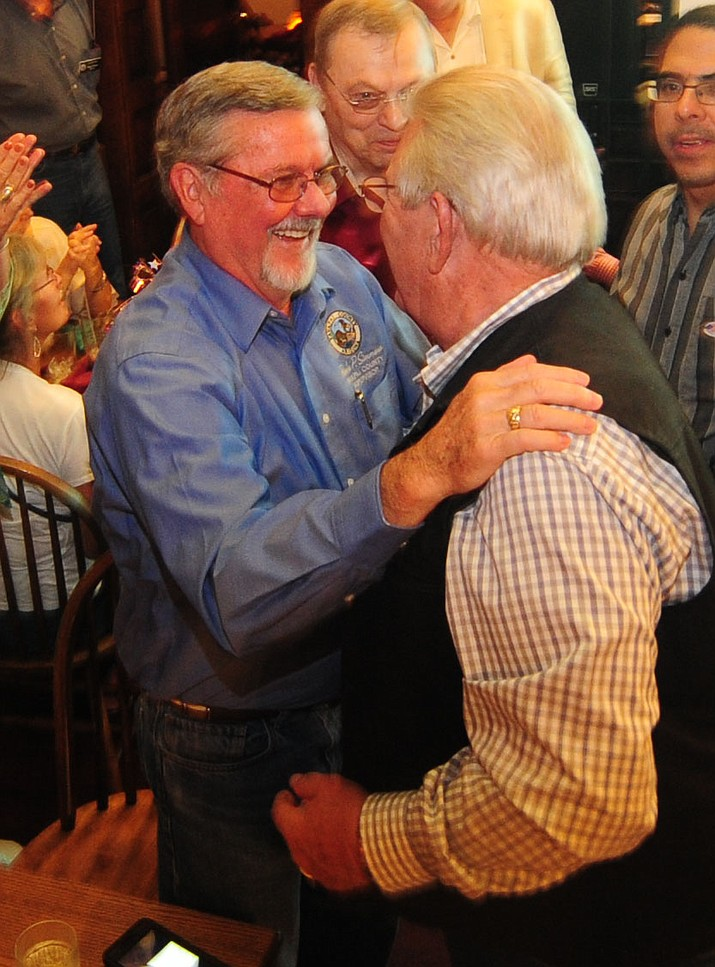 Yavapai County Supervisors Rowle Simmons and Craig Brown celebrate being reelected as Republicans gathered at The Palace Restaurant and Saloon for primary election results Tuesday, August 30, 2016. (Les Stukenberg/The Daily Courier)