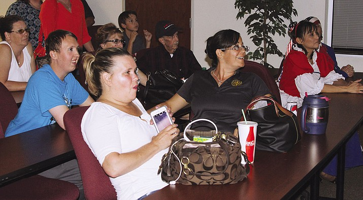 Candidates and spectators make a night of it in the County Administration Building, watching the primary votes roll in.
