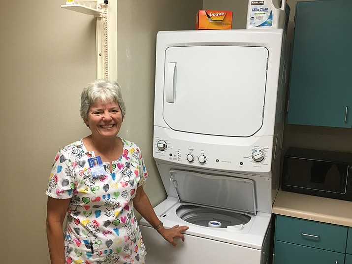 Donna McBroom, the nurse at Territorial Early Childhood Center, stands in front of the washing machine and dryer that the Chino Valley Morning Lions donated last year.