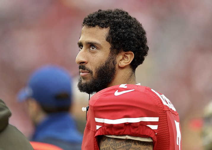 In this Nov. 8, 2015, file photo, San Francisco 49ers quarterback Colin Kaepernick stands on the field during an NFL football game against the Atlanta Falcons in Santa Clara, Calif. Kaepernick's protest of the national anthem over what he describes as oppression of minorities in the United States is apparently winning support from some veterans on Twitter under #VeteransForKaepernick. Kaepernick said he'll continue the protest during San Francisco's preseason game at San Diego on Thursday, Sept. 1, 2016.