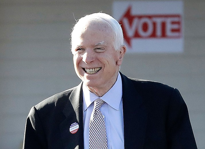 U.S. Sen. John McCain, R-Ariz., leaves a polling station after voting, Tuesday, Aug. 30, in Phoenix.