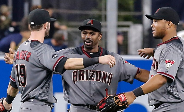 Arizona Diamondbacks outfielders Mitch Haniger, left, Michael Bourn, center, and right fielder Yasmany Tomas celebrate their 2-1 win over the San Diego Padres on Saturday, Aug. 20, in San Diego.