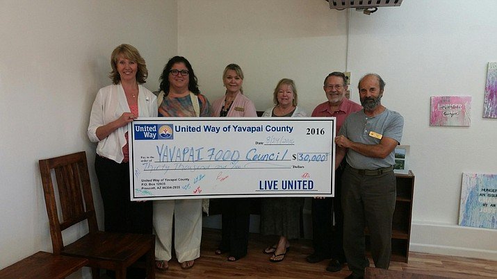 The United Way of Yavapai County selected the Yavapai Food Council to receive a $30,000 grant to support their 2016-17 programs. In 2015, the council distributed some 542,943 meals. Here, United Way of Yavapai County Executive Director Annette Olson, left, presents check to Yavapai Food Council Board of Directors. From left of Olson are Council Executive Director Amy Aossey, Board members Cindy Holcombe, Abbie Denton, Board President Harvey Grady and Richard Sidy.