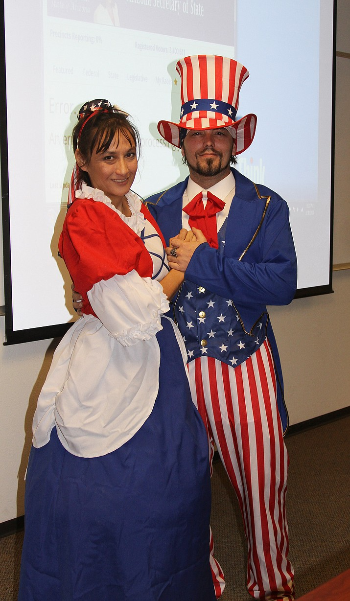 Alicia Hartwig and Rocky Sapp got dressed up in the patriotic spirit as they campaigned for Mohave County Sheriff candidate Cori Merryman on Tuesday night.