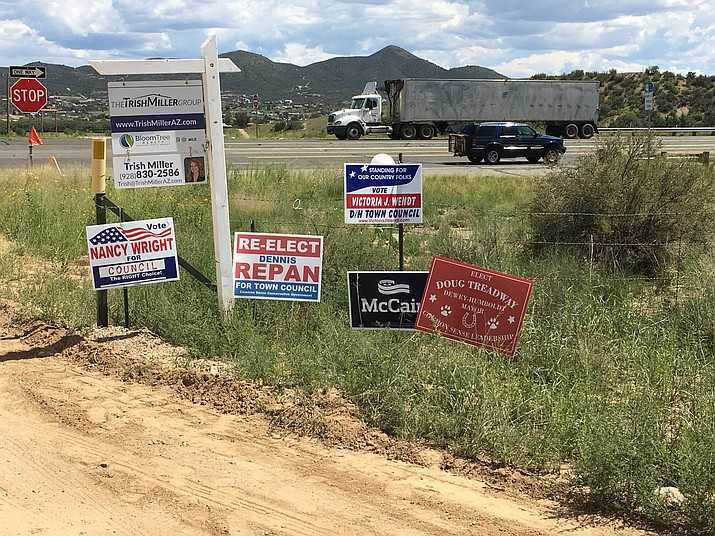 Campaign signs outside the voting center in Dewey-Humboldt on Tuesday, Aug. 30, 2016.