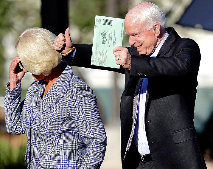U.S. Sen. John McCain, R-Arizona, and his wife, Cindy McCain, arrive to vote at a polling station, Tuesday, Aug. 30, in Phoenix. McCain won the republican nomination in Arizona's primary election.