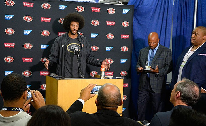 San Francisco 49ers quarterback Colin Kaepernick talks to the media at a news conference an NFL preseason football game against the San Diego Chargers Thursday, Sept. 1, in San Diego.