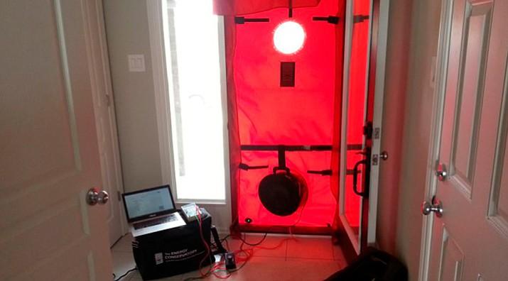 Blower door and duct test in progress.
