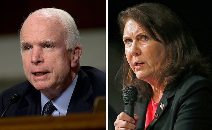 In this combination of file photos, Sen. John McCain, left, R-Ariz., speaks during a committee hearing on Capitol Hill in Washington, and U.S. Rep. Ann Kirkpatrick answers a question during a Congressional District 1 debate with in Tucson. An Arizona Republican Party spokesman is defending the release of a wanted poster for Kirkpatrick, a Democrat challenging McCain in Arizona's U.S. Senate race. Kirkpatrick's campaign and former U.S. Rep. Gabby Giffords say the poster includes bullet holes and that it's inappropriate imagery related to violence. State GOP spokesman Matt Specht disputes that the wanted poster depicts bullet holes and he says it's just an old-fashioned weathered image from the Old West.