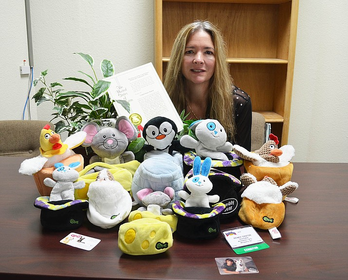 Renee Gratza with versions of her pet toy she invented. There are versions for both dogs and cats.
