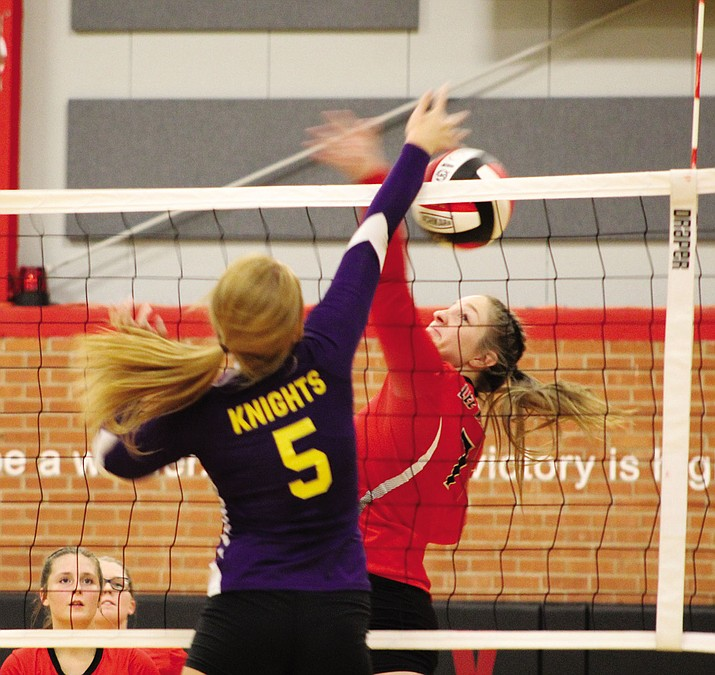 Kristen Finch (7) battles Lake Havasu's Kaycee Olsen over the net during Tuesday's match at Lee Williams High School. Finch and Lady Volunteers swept Havasu, 25-16, 25-23, 25-18.
