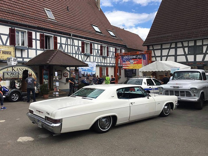 The scenes at the European Route 66 Festival in Ofterdingen, Germany, included long-bodied cars from years ago and a Harley-Davidson tricked out in a cowboy motif.