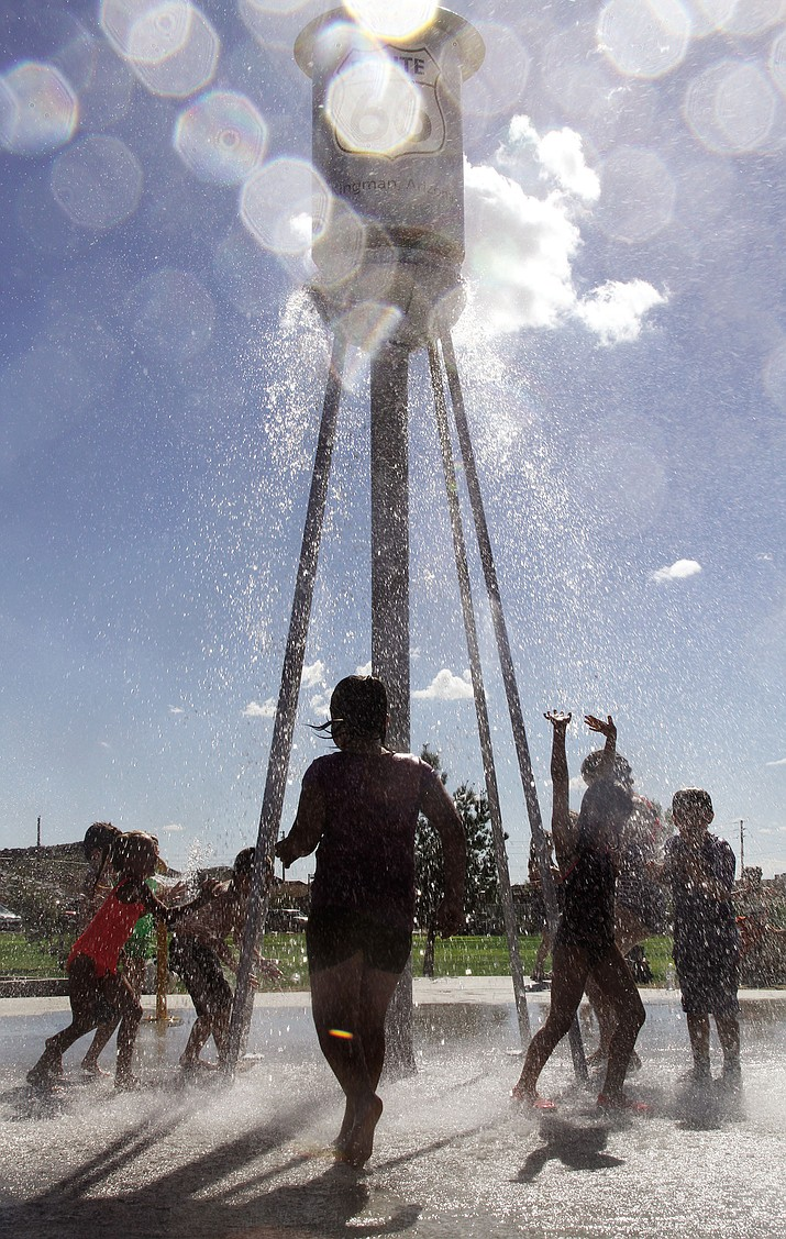 Joy mixed with water for children at the Splash Pad at Cevcil Davis Park Friday.